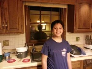 Ethan enjoying cleaning dishes...